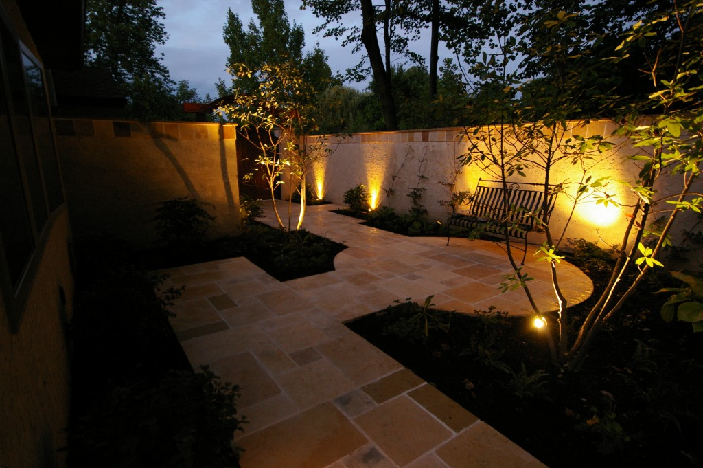 The feature and area lights accent specific sections of the walkway to visually attract visitors and guide them through the path.
