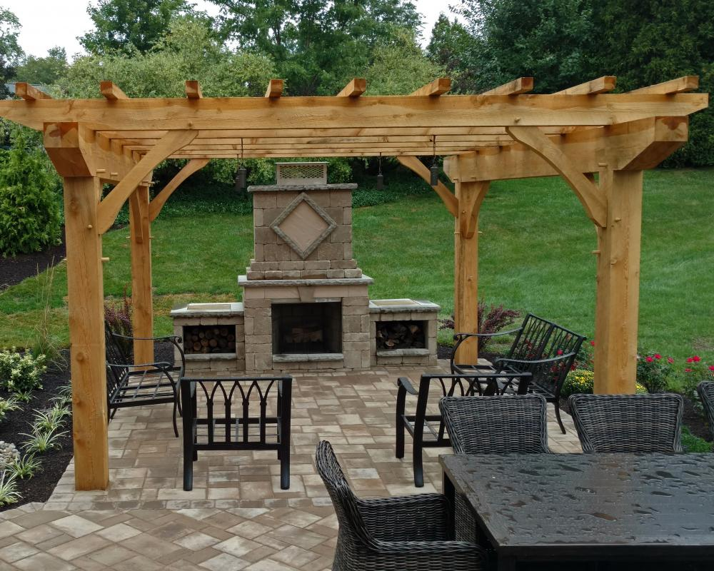 outdoor fireplace and timber frame pergola