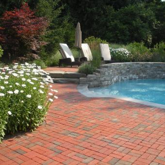 swimming pool with brick patio
