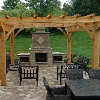 An outdoor fireplace and patio landscape project by Allentown Hardscaping Company Garden Design Inc. The project included Techo-bloc paver patio and paver walkway