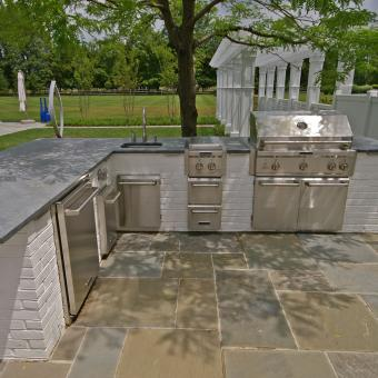 flagstone patio with outdoor kitchen